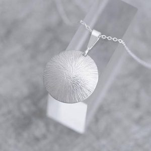 silver pendant, round sterling silver pendant with hammered finish by iana jewellery