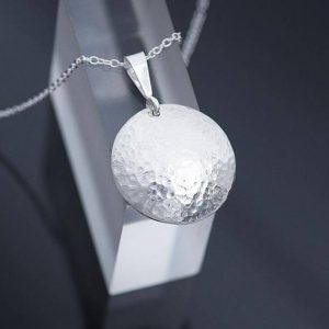 silver pendant, round silver bpendanr with hammered finish of sterling silver made by iana Jewellery
