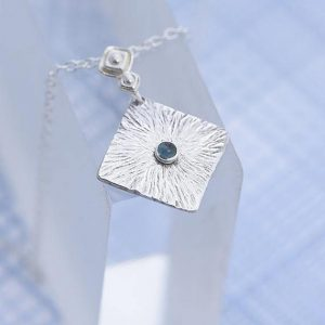 Topaz Pendant, silver pendant with blue Topaz in the centre made by Ian Caird of iana Jewellery
