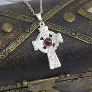 Garnet Pendant, Silver pendant in the shape of celtic cross with Garnet in the centre by iana Jewellery