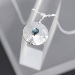 Topaz Pendant made of round sterling silver with hammered finish by Ian Caird of iana Jewellery