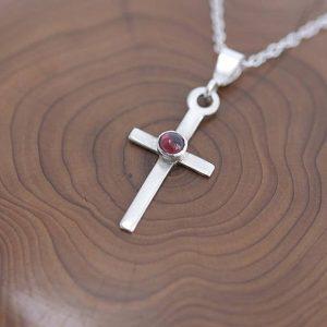 Garnet Pendant, silver cross pendant with Garnet gemstone in the centre by iana Jewellery