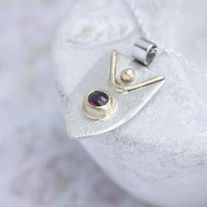 Garnet Pendant made with silver and 9ct gold by Ian Caird of iana Jewellery
