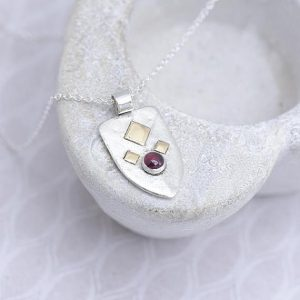 garnet_pendant made of sterling silver in the shape of a shield by iana Jewellery