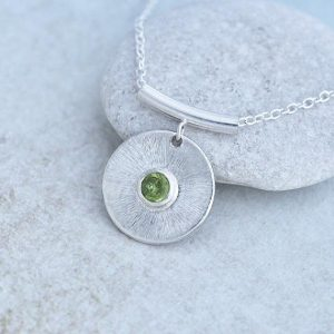 Peridot Pendant, round silver pendant with Peridot stone in the centre by iana Jewellery