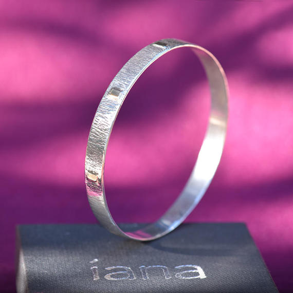 silver and gold bangle